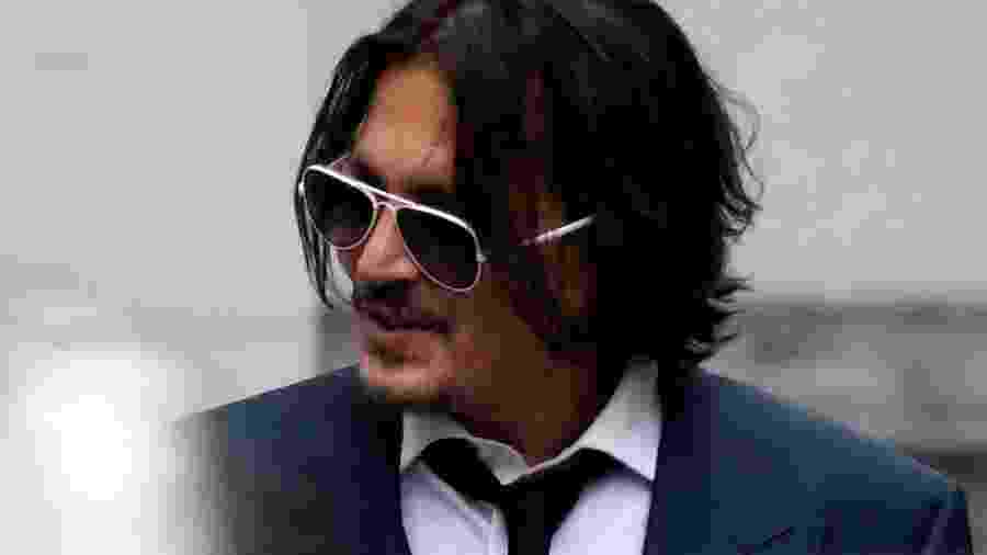 Johnny Depp comparece a tribunal em Londres para julgamento - TOBY MELVILLE