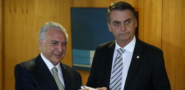 7.nov.2018 - Jair Bolsonaro e o presidente Michel Temer durante reunião