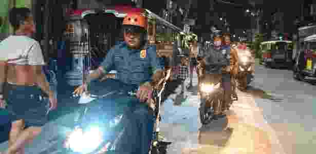 Policiais patrulham as favelas de Tondo, um distrito de Manila, nas Filipinas - Hannah Reyes Morales/The New York Times - Hannah Reyes Morales/The New York Times