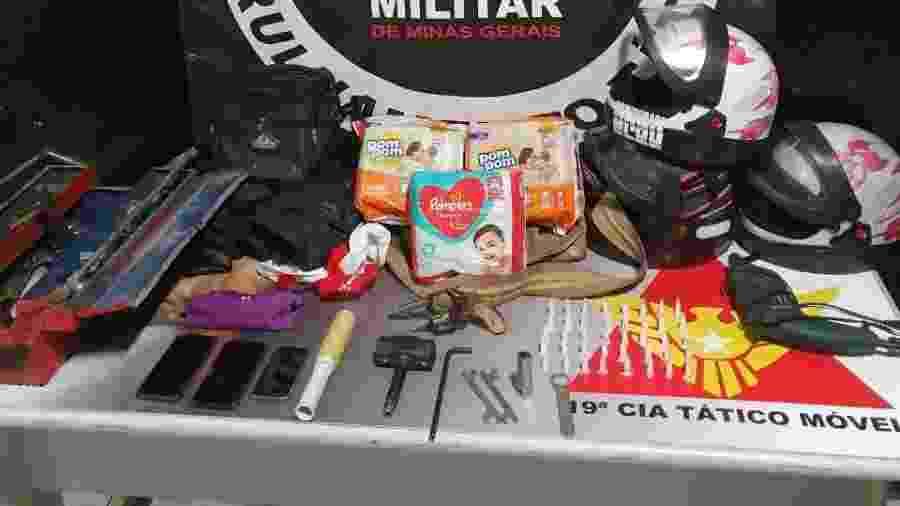 Polícia prende trio que usava bebê para furtos e apreende drogas, armas e até fraldas - Divulgação/PMMG