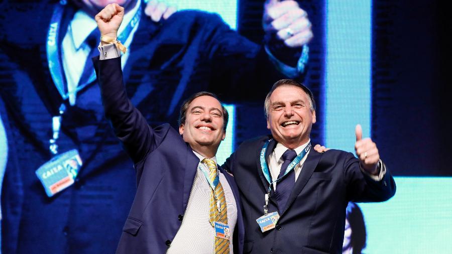 Presidente Jair Bolsonaro ao lado do presidente da Caixa, Pedro Guimarães - Isac Nóbrega/PR