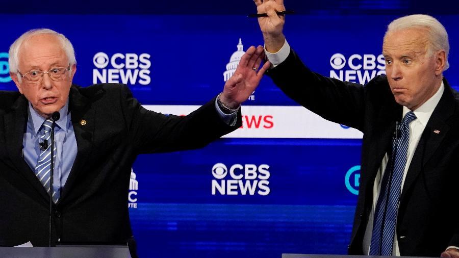 Pré-candidatos democratas Bernie Sanders (esq) e Joe Biden (dir) - Jonathan Ernst