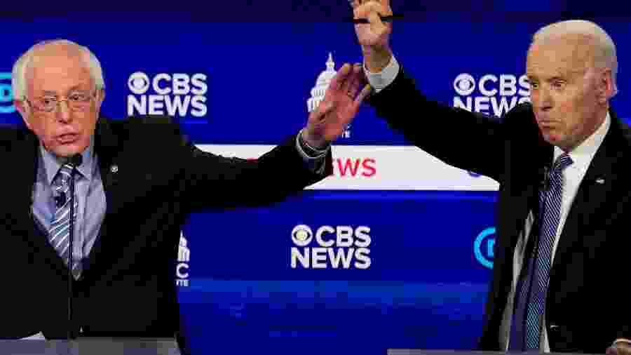 Pré-candidatos democratas Bernie Sanders (a esq.) e Joe Biden - Jonathan Ernst