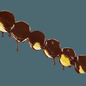Espeto de banana com chocolate, servido no espeto, da franquia  Fábrica Di Chocolate - Divulgação