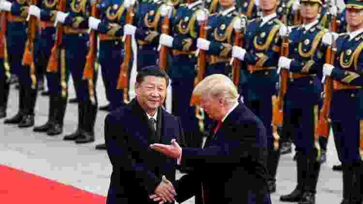 Os dois protagonistas da guerra comercial: Donald Trump, presidente dos EUA, e Xi Jinping, presidente da China - Damir Sagolj/Reuters