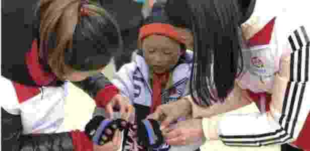 Menino chinês ganha roupas após foto de seu cabelo congelado no frio viralizar - Reprodução - Reprodução