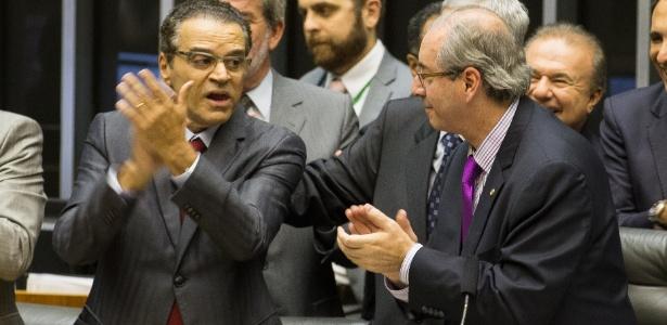 10.fev.2015 - O ex-deputados Henrique Eduardo Alves (à esq) e Eduardo Cunha