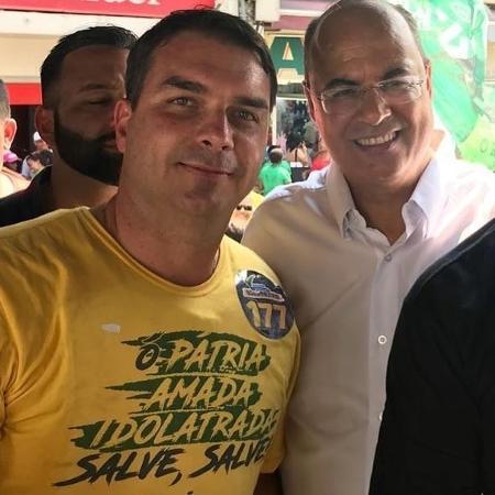 Flávio Bolsonaro (PSL) e Wilson Witzel (PSC) em evento de campanha eleitoral em 2018 - Reprodução