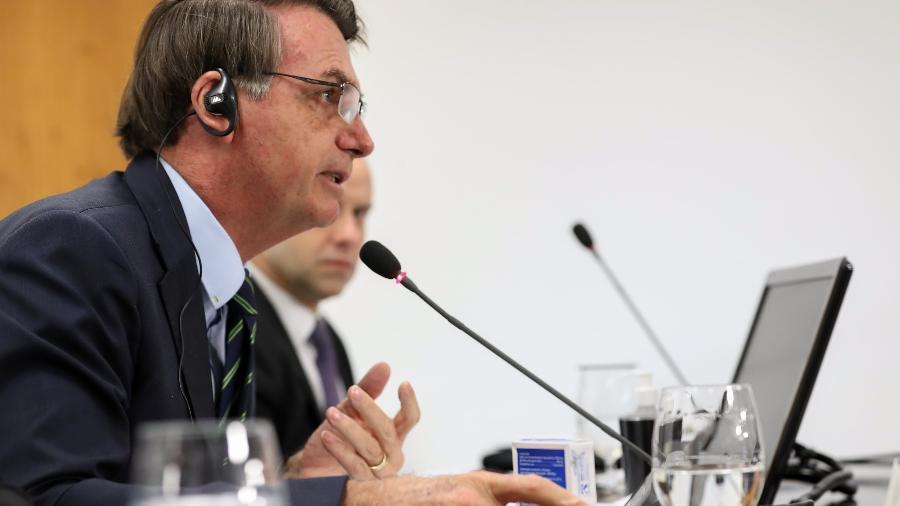 26.mar.2020 - O presidente Jair Bolsonaro participa, em Brasília, de uma videoconferência dos líderes do G20 - Marcos Corrêa/Presidência