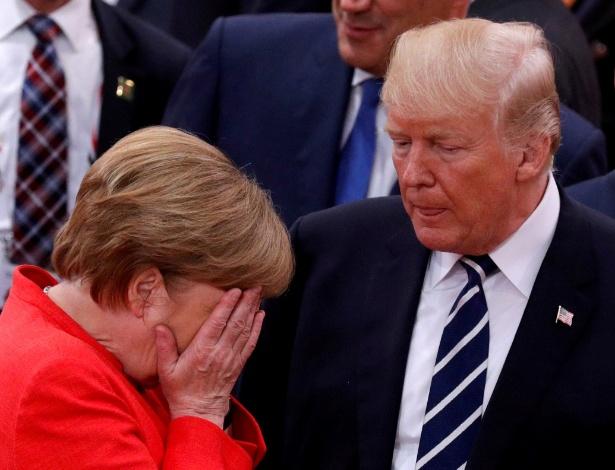 7.jul.2017 - A chanceler alemã Angela Merkel reage ao lado do presidente dos EUA, Donald Trump, durante a reunião do G20, em Hamburgo - Philippe Wojazer/ Reuters