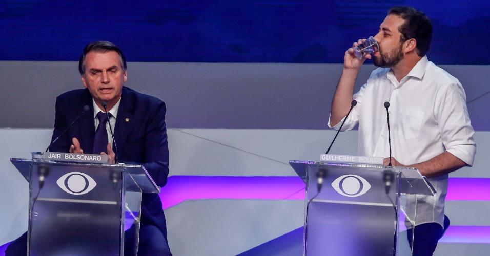 9.ago.2018 - Jair Balsonaro (PSL) e Guilherme Boulos (PSOL) durante o debate Band 2018 com os candidatos a presidencia da republica, que acontece na TV Bandeirantes no bairro do Morumbi em São Paulo nesta quinta (9)