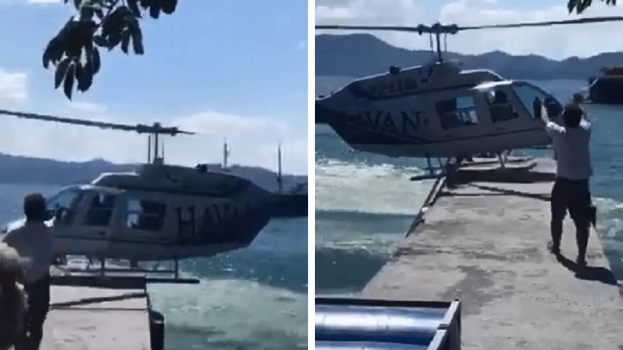Helicóptero com adesivo da loja de departamentos Havan tenta pousar em píer, em uma praia de Porto Belo (SC) - Reprodução/Facebook