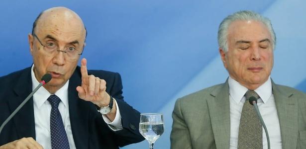 15.dez.2016 - O presidente Michel Temer, acompanhado do ministro Henrique Meirelles (Fazenda)