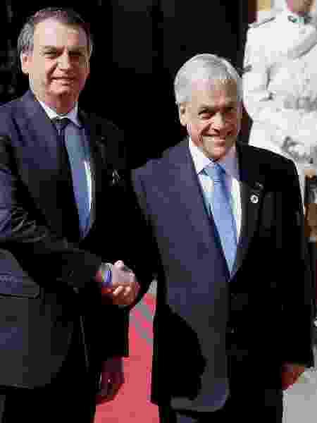 Jair Bolsonaro durante encontro com o presidente do Chile, Sebastian Piñera - Rodrigo Garrido/Reuters