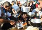 Em Mossul, a ameaça de um caos humanitário - Bulent Kilic/AFP