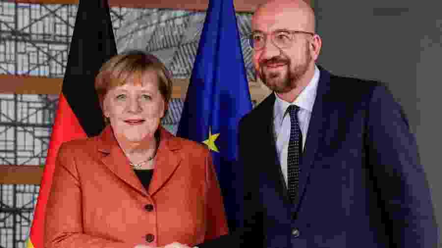 12.dez.2019 - A chanceler da Alemanha, Angela Merkel, e o presidente do Conselho Europeu, Charles Michel, em evento da UE - Stephanie Lecocq/Pool/AFP