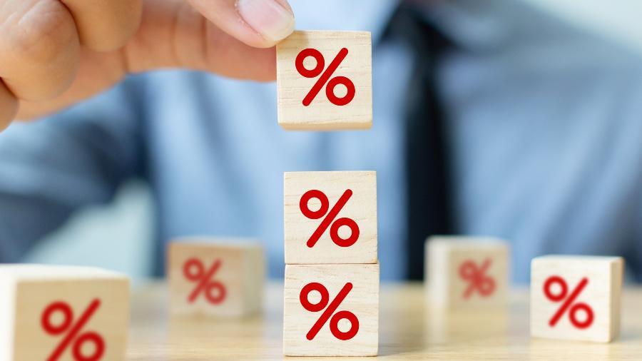 juros, taxa de juros, porcentagem, desconto - Getty Images