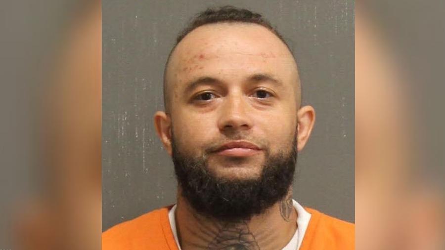 O suspeito, identificado como Robert Miquel Johnson, de 31 anos, foi acusado de matar a namorada mais de um mês após a morte dela - Metro Nashville Police Department