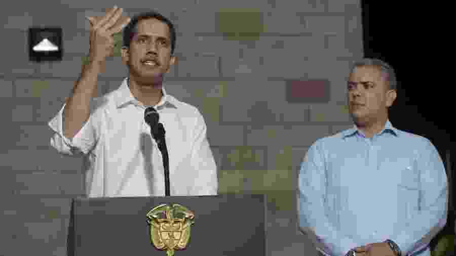 23.fev.2019 - Juan Guaidó, autoproclamado presidente da Venezuela, discusa ao lado de Ivan Duque, presidente colombiano - Raul Arboleda/AFP