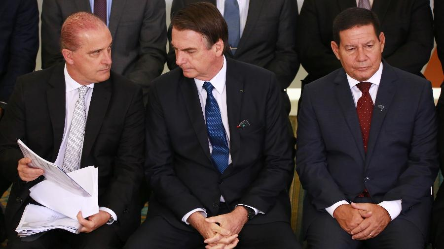 11.abr.2019 - Onyx Lorenzoni, Jair Bolsonaro e Mourão durante solenidade alusiva aos 100 Dias de Governo do presidente Jair Bolsonaro, realizada no Palácio do Planalto, em Brasília  - Fátima Meira/Futura Press/Estadão Conteúdo