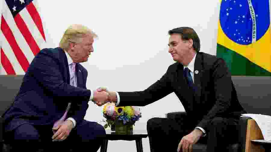 30.jul.2019: encontro de Donald Trump e Jair Bolsonaro durante reunião em Osaka, no Japão - Kevin Lamarque/Reuters