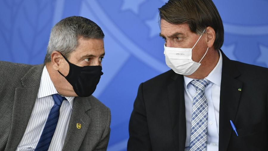 O presidente da república, Jair Bolsonaro, e Walter Braga Netto, ministro da Defesa - Mateus Bonomi/Agif/Estadão Conteúdo