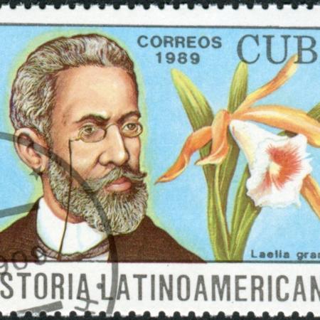 Selo cubano com a imagem de Machado de Assis, um dos maiores nomes do Realismo brasileiro.* - Escola Kids