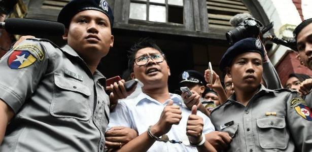 Jornalistas da Reuters foram condenados a sete anos de prisão em Mianmar - YE AUNG THU / AFP