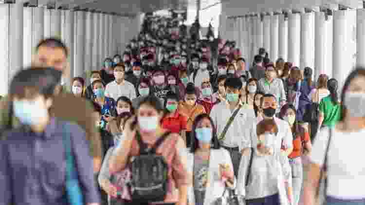 Pessoas com máscara - TZIDO SUN/Shutterstock - TZIDO SUN/Shutterstock