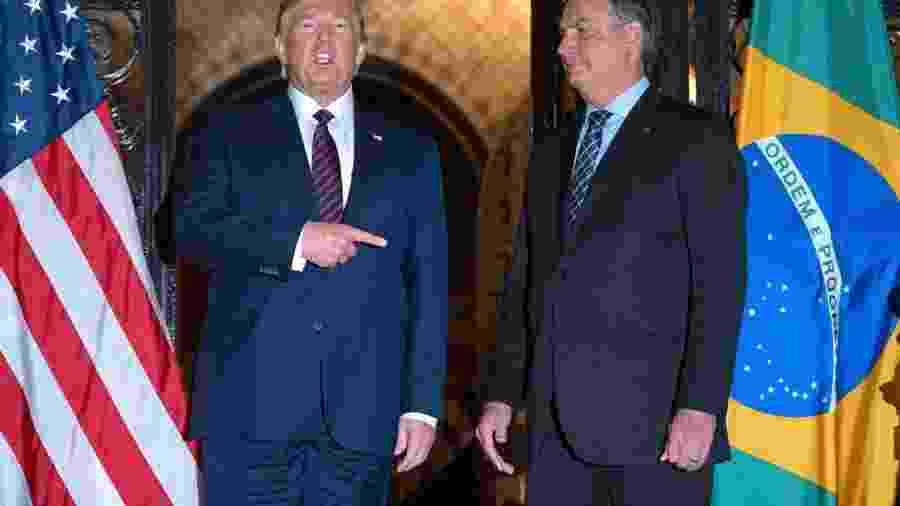 Os presidentes dos EUA, Donald Trump, e do Brasil, Jair Bolsonaro. Após derrota do americano nas urnas, votações na ONU têm adesão menor aos EUA, mas Brasil segue entre aliados - JIM WATSON/AFP