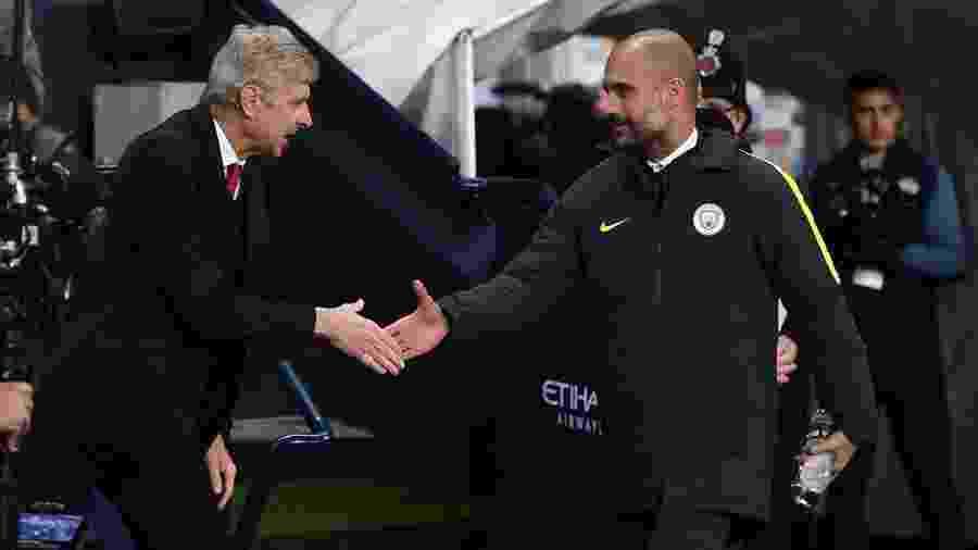 Wenger e Guardiola se enfrentam neste domingo pela final da Copa da Liga Inglesa - false