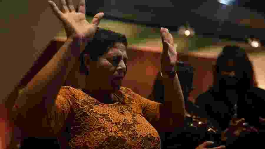 Fiel em culto na Conferência Nacional da Frente Parlamentar Evangélica do Congresso Nacional, em Brasília - Mateus Bonomi/Folhapress (18.12.19)