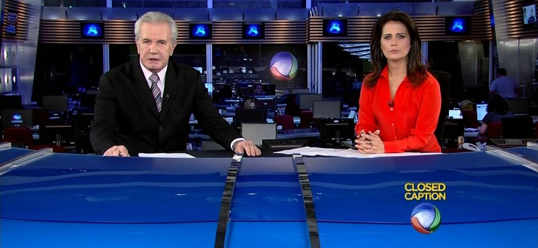 Celso Freitas e Adriana Araújo, âncoras do Jornal da Record - Reprodução
