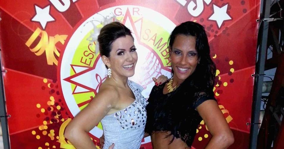 5.jan.2013 - Tânia Oliveira, madrinha de bateria da escola de samba Tom Maior, recebeu a ex-BBB Kelly Medeiros em ensaio da escola neste sábado (6)
